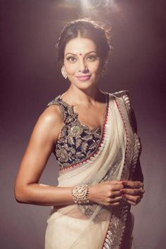 Love this intricate blouse with simple sari on Bipasha Basu.