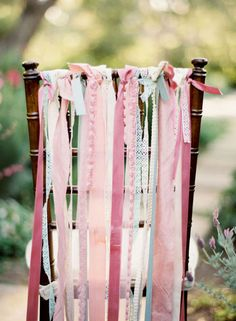 Tie some simple pink ribbons on the bride and grooms chair