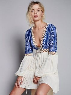 ☆Dusk 'Til Dawn Mini   Long sleeve mini dress featuring a gauzy fabrication and pretty tribal-inspired embroidery on the bodice. Deep V-neckline with adjustable tassled tie closure at the back. Peekaboo crochet panels throughout. Drawstring ties on the sleeve cuffs. Lined.