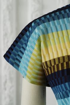 Julie McConnachie   ---- Love this.  Ribbed, striped, plating technique??