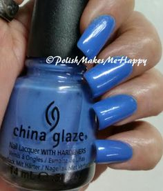 "China Glaze Nail Lacquer ""Rainstorm"". It's a periwinkle blue, but I wasn't too successful in capturing the true color of this polish. Sprinkled throughout are micro-glitters of blue with a flash of pink if seen just right."