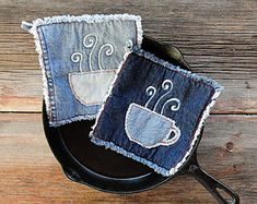 Thick, long wearing, good looking and unique. These wonderful denim potholders are great fun for gift giving. You will love these potholders!  Embellished with a spoon and fork in my signature shaggy denim applique style.  Great for use: on the grill, at the cabin, on the boat, picnics, housewarming and other gifts. I give these for gifts all the time, it seems everyone needs needs new potholders but doesnt remember to buy them.  Dont forget you need potholders too!   - Sold in pairs…