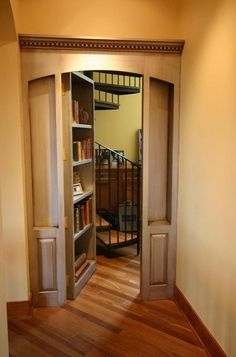 secret bookcase doorway leading to private library loft