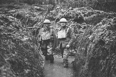 MirrorpixTwo British soldiers stand in a flooded communications trench on the Western Front, 1917