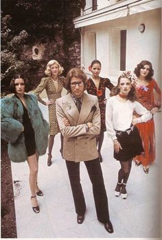 Yves St Laurent with a bevy of beauties