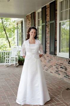 Lucy modest wedding dress, no train, 3/4 length sleeves on lace jacket. #modestbride #modestweddingdress #notrain