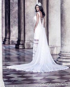 """Ρομαντικά νυφικά δαντέλα με ανοικτή πλάτη : """"d.sign by Dimitris Katselis"""" Real bride . Νυφικό από δαντέλα σε ρίγες , ραμμένη στο χέρι, με έμφαση στην πολύ ανοικτή πλάτη , την μεγάλη ουρά από τούλι και τις ντραπέ λεπτομέρειες."""