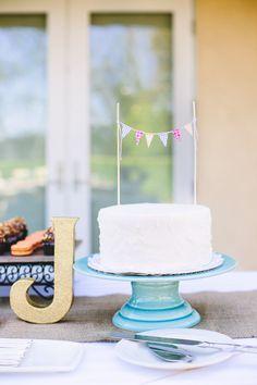 simple white wedding cake // photo by Mary Costa Photography // cake by Rising Hearts Bakery // View more: http://ruffledblog.com/handmade-san-diego-garden-wedding/
