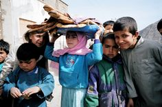 Afghanistan. Children Carry Naan Bread -