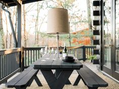 DIY Network shares step-by-step instructions on how to dress up a basic picnic table with paint, a floor lamp and lamp parts. Outdoor Dining Furniture, Outdoor Rooms, Outdoor Living, Outdoor Decor, Outdoor Steps, Outdoor Landscaping, Painted Picnic Tables, Picnic Table Paint, Backyard Fireplace
