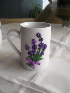Hello! Elegant lavender pattern was made by polymer clay, the mug is ceramic. It s a perfect gift to your best friend or your love.  Handmade item, it take 1-2 weeks to make it.  Decor from polymer clay glued to the cup, so a cup can be used as usual. Wash with warm water by hand, do not put in the microwave and dishwasher.  Volume: 250 ml Material: ceramic mug, polymer clay.  Have a nice day! :)