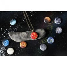 Interchangeable Solar System Necklace With 10 Designs:  great look, but I'd want them to be waterproof (sweat, rain, etc.)