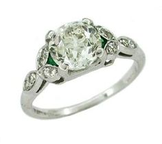 Antique Diamond and Emerald Platinum Engagement Ring...I'm in love with this..diamond and emerald..too expensive tho