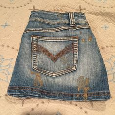 Younique jean skirt This skirt is very unique! It has copper colored stitching that makes a cool pattern on the back pockets and random gold markings all over. It is stretchy, so could potentially fit a little bigger size. Very lightly worn! Great condition! Size 9* Younique Skirts Mini