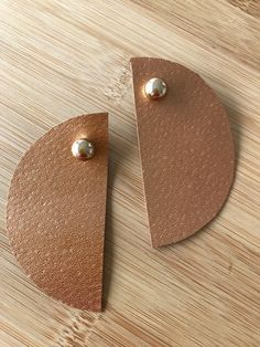 The product Copper leather semi circle wonderwoman earrings is sold by Crea-tiff bijoux in our Tictail store.  Tictail lets you create a beautiful online store for free - tictail.com