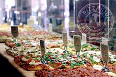 Pizzarium, Gabriele Bonci's pizza restaurant in Rome AFAR MAGAZINE: al taglio, rectangular slices of pizza, is made from heirloom wheat and topped with rotating ingredients.