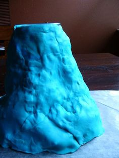 Ecuador - Erupting Volcano:  These are so much fun to make, and you can erupt them multiple times!  Build up playdough around a cup to form the shape of a volcano. Add baking soda and red food coloring to the cup. Eruption is messy, so place volcano inside a large plastic tub or do the next step outside! Pour a bit of white vinegar into the cup to see it erupt.