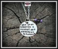 This listing is for 1 necklace.  This adorable keepsake necklace features a loving quote that says  The love between a mother and daughter is