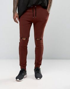 Get this Asos's joggers now! Click for more details. Worldwide shipping. ASOS Super Skinny Joggers With Knee Rips In Dark Red - Red: Joggers by ASOS, Loop-back sweat, Knee rips, Drawstring waistband, Side pockets, Fitted cuffs, Regular fit - true to size, Machine wash, 100% Cotton, Our model wears a size Medium and is 6'1�/185.5 cm tall. ASOS menswear shuts down the new season with the latest trends and the coolest products, designed in London and sold across the world. Update your go-to…