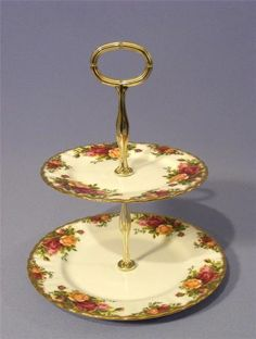A stunning two tiered Cake Stand from Royal Albert Old country rose range Fully back stamped with the Royal Albert, Old Country Rose Made in England Lovely gold coloured central column Bright, lustrous gilding Country Rose, Antiques Online, Royal Albert, Cooking Utensils, England, Range, Bright, Gold, How To Make