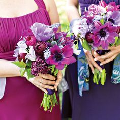 The bridesmaids wore dresses from David's Bridal and carried bouquets of anemones, sweet peas, ranunculuses, tulips, and hyacinths in shades of lavender and magenta. Photo: Katie Stoops.
