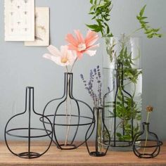 West Elm flower arrangers that appear like line drawings come to life.
