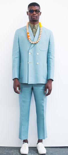 David Hart's spring-summer 2016 collection explodes with color, capturing all the hues of the rainbow. Offering a flashy take on dapper menswear classics, the lineup provides pastel summer-weight suiting that is contrasted against eveningwear that boasts graphic prints. On the more casual side, smart shorts are paired with shirts and knitwear decorated in geometric patterns. #NYFWM2016