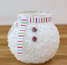 glass jar decorated like snowman body