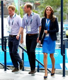 Eyes front! Kate turns soldiers' heads as she joins Wills and Harry at the Commonwealth Games to watch the athletics | Mail Online