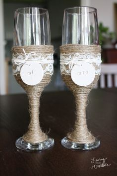 Make these DIY rustic wedding champagne flutes with this tutorial from Living YOUR Creative! (Rustic Decorated Bottle)