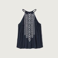 Abercrombie & Fitch Embroidered High Neck Tank ($38) ❤ liked on Polyvore featuring tops, navy, embroidered tank, draped tank top, navy blue tank, grommet top and high neckline tank top