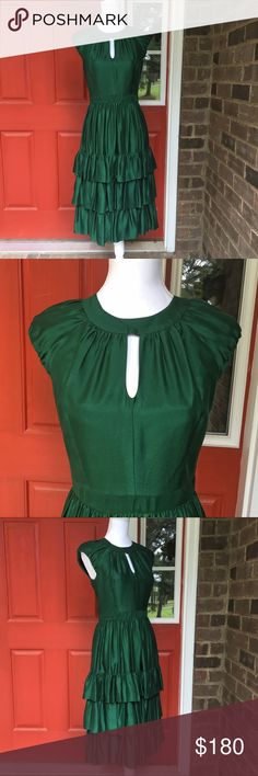 Milly Original Green Tiered Dress with Bow This gorgeous dress is simply breathtaking. The tiered skirt is flowy and classic. The dress has 100% silk outer, polyester lining. Bow keyhole detail on the back. In great condition. 30278 Milly Dresses Midi