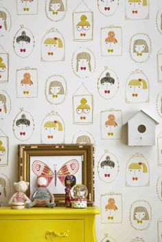 A fun wallpaper design features various cameos of little girls and their hairstyles in small frames.