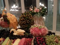 Looking for some ideas for wedding carving arrangements. See the lovely vegetable and fruit carving displays created by Saada Al -Taie for weddings. Fruit Presentation, Fruit And Vegetable Carving, Some Ideas, Fruits And Vegetables, Display, Table Decorations, Create, Wedding, Home Decor