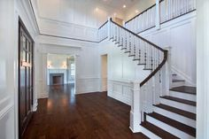 The two-story foyer features floor-to-ceiling recessed paneled wainscoting, a low-relief coffered ceiling and electronic chandelier lift for easy cleaning and bulb-changing. Photo: Contributed Photo / CT