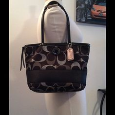 """Authentic Coach Signature C Purse.  Beautiful and Authentic Coach purse, with serial number inside, black, silver and grey signature C fabric, genuine black leather straps, silver metals, black inside. Good condition, clean, no flaws. 10"""" X 14"""" X 4""""  -No trades. -No holds. -No more discounts for this bag, It is not easy to find good prices for reselling, do not ask for lower prices Please.  Click the listings to see the boutique.  Thanks for your visit ;-) Coach Bags Shoulder Bags"""