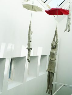 "These cement figures dangling from umbrellas within a narrow space inside the EBC office center in Prague are part of a installation titled ""Slight Uncertainty"" by Czech artist Michal Trpák. Ceramic Sculpture Figurative, Ceramic Sculptures, Umbrella Art, Colossal Art, Art Plastique, Sculpture Art, Concrete Sculpture, Sculpture Ideas, Installation Art"