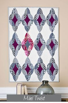 """27"""" x 36"""" Pattern to be used with QCR Mini Ruler Materials: (9) fat eighths assorted gray prints (6) 5""""x 5"""" assorted plum prints 1/2 yard solid berry fabric (2) 5"""" x 5"""" dark gray solid fabric 1 1/8 ya"""