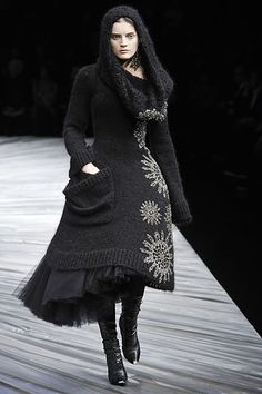 Alexander McQueen Fall 2008 channels goth, marked by conspicuously dark, mysterious, exotic, and complex features. The hood adds to the mystery of the wearer. McQueen is a lover of gothic style, it appears in many of his lines. . 4/5/15.