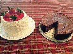 Chocolate cheesecake and strawberry topped vanilla cake