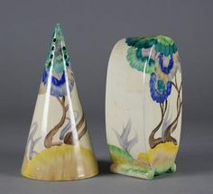 Two Clarice Cliff sugar sifters from the Bizarre range. Decorated in overglaze enamels with the Viscaria pattern. One of conical shape and the other bonjour. Printed marks. Tallest 13 cm.