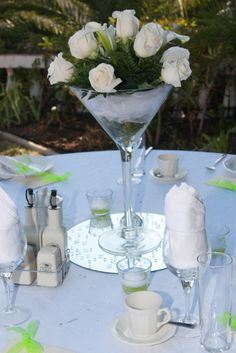 Beautiful White Roses in a tall Martini glass.