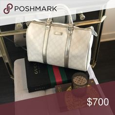 Gucci Joy Medium Boston Bag White + Metallic Gucci Joy Medium Boston Bag. No trades or modeling. Authentic + from a Gucci store. Has had one owner. A rare, no longer in production style + color. The perfect bag for Spring, Summer & Cruise Vacation.  Photos show condition in full. Only major signs of wear are on bottom. It was set it down at a restaurant and I'm not sure what the spots are.  Ships as handbag only. No dust bag or box. Will be wrapped with care & Posh Concierge will repack…