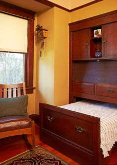 The first-floor office features a built-in, drop-front writing desk, below which is a twin hideaway bed.