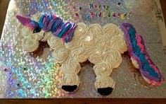Unicorn cake!! Easy To make pull apart cupcake cake. My daughter Chelsie LOVES unicorns and wanted a unicorn cake.. So I found some ideas for horse versions of the cake, used the template, and just frosted a sugar cone and rolled it in sugar sprinkles for the horn. It was hard to find a big enough cake board so I used a foam project board from Michaels, it was a lot sturdier.