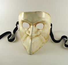 """Origins of the Bauta mask can be traced back to the 13th Century. The mask was designed to protect and perfectly disguise the identity of the men and women who wore it; which allowed total freedom of actions. The mask's form allowed the wearer to eat and drink without having to remove the mask and reveal their identity.    The mask's dimensions are approximately 6 ¼"""" wide, 6"""" high and 6 ½"""" deep."""