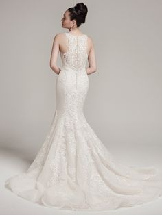 Rae by #SotteroandMidgley   Swarovski crystals adorn this modern lace and tulle fit and flare wedding dress with sexy illusion sweetheart neckline and soft-sweeping train. Finished with intricate illusion lace back and crystal buttons over zipper closure.
