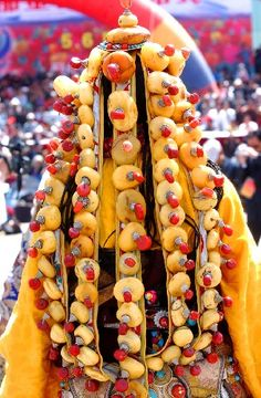 Show interspersed Tibetan headdress with agate and coral .