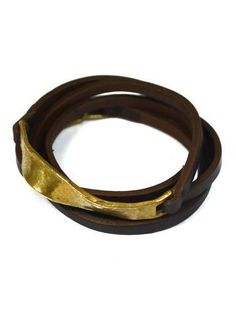 """Effect Wrap Bracelet Fair Trade •Bent & formed buckles made of brass and white bronze •Skinny genuine hand-dyed recycled leather wrap bracelet •Wraps 5 times and fits wrist approximately 6.5"""" in diameter Artisan Country: Bali #Shoppingforachange $39.00 USD"""