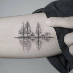 A quiet lake in winter tattoo on the right arm.... - Little Tattoos for Men and Women